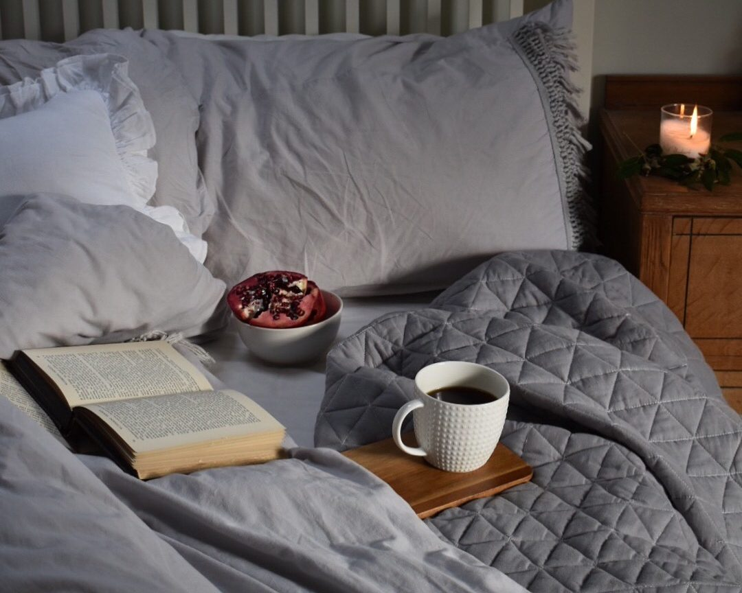 Cosy bed with coffee