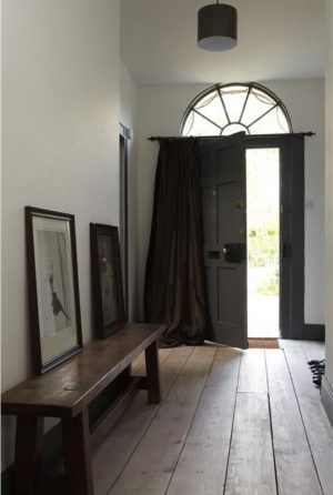Interiors Inspiration - decor ideas for a white hallway - down pipe grey door